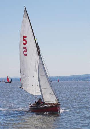 propel: A yatch taking part in a race speeds across the sea