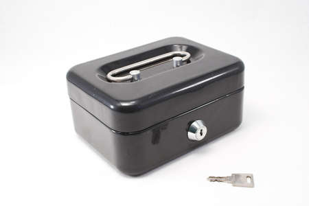 A locked strongbox and its key Stock Photo