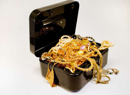 A treasure chest filled with jewelry Stock Photo