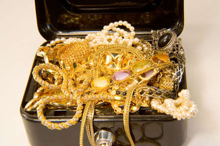 strongbox: A treasure chest full of gold and jewels Stock Photo