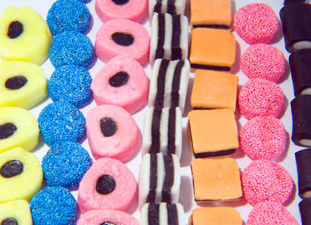Background pattern made from sweets in lines Stock Photo