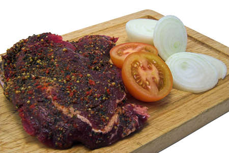 peppered: Peppered steak,onions and tomatos ready for cooking. Stock Photo