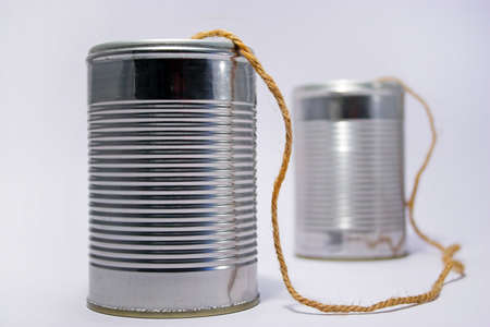 A telephone made from tin cans Stock Photo