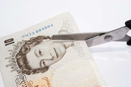 depreciation: Cutting your money down to sixe Stock Photo