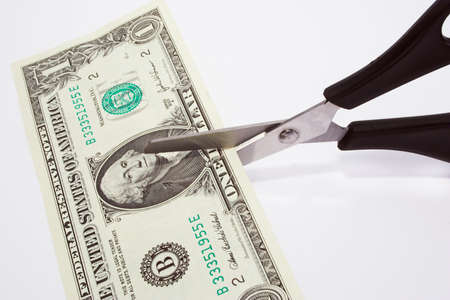 Cutting your money down to size Stock Photo