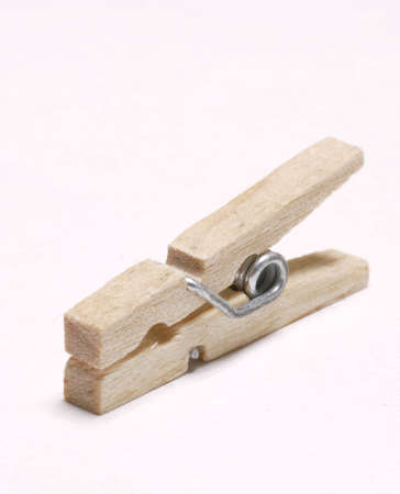clothepeg: one wooden clothes peg on white background