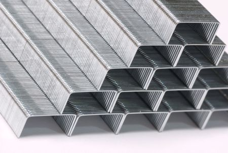 schemes: close up of staples stacked in a pyramid shape