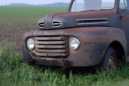 rusty old pick up truck in rural field photo
