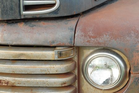details on the front of a rusted old pick up truck photo