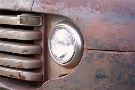 salvage yards: close up details on a rusted out vintage pick up truck