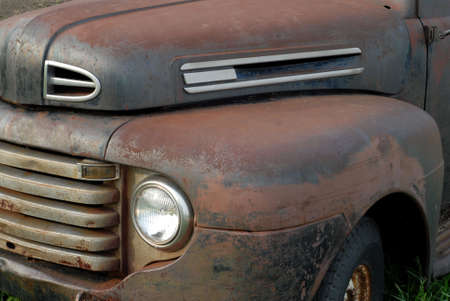 close up details on a rusted out vintage pick up