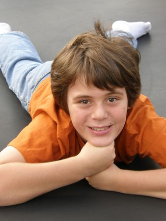 happy good looking pre teen boy enjoying life Stock Photo - 2100848