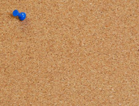 pin board: cork board with blue push pin or thumb tack