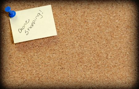 posted: cork board with note posted saying gone shopping Stock Photo