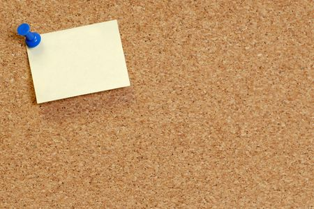 pin board: cork board with blank note attached with thumb pin Stock Photo