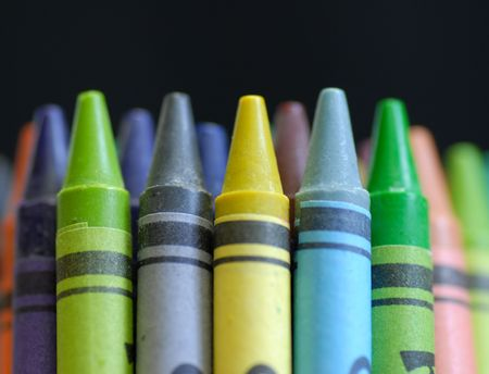 clustered: colorful crayons standing up on black background Stock Photo