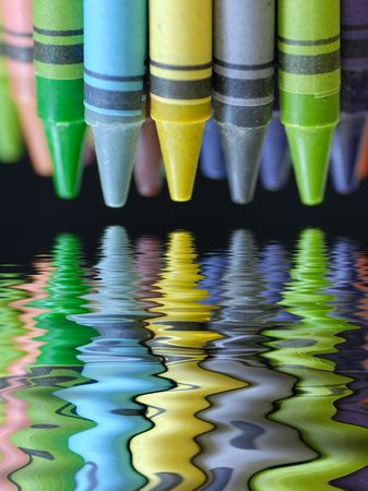 clustered: colorful crayons with beautiful reflection on black background