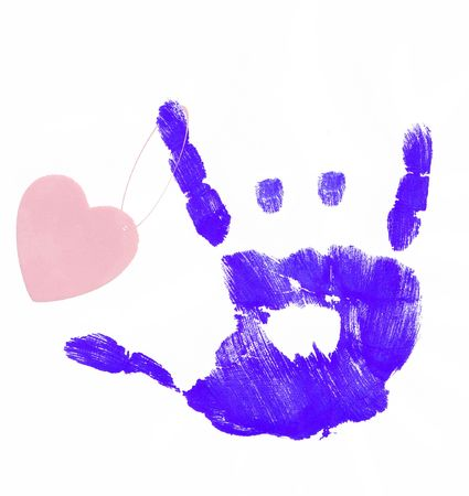 nonverbal communication: finger painted hand making rock on sign with heart attached