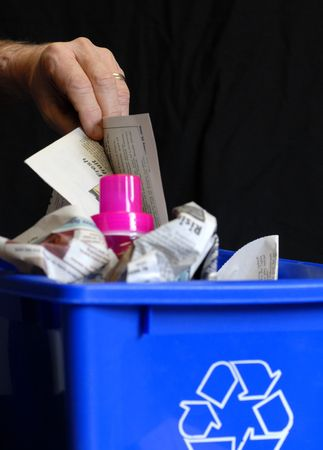 utilize: hand putting recycling in bin with plastic and paper Stock Photo