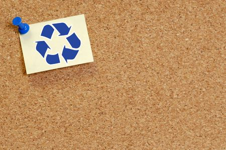corkboard with recycle symbol on thumb tacked note Stock Photo