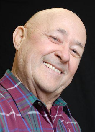 big smile: happy bald senior man with big smile