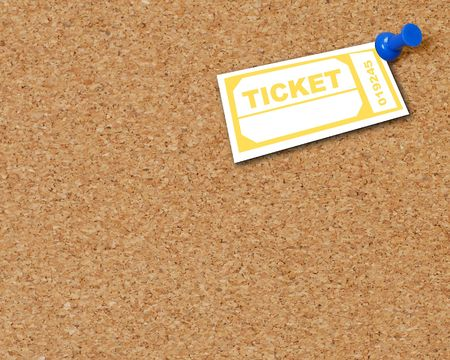 yellow ticket thumb tacked to corkboard  - room for copyspace photo