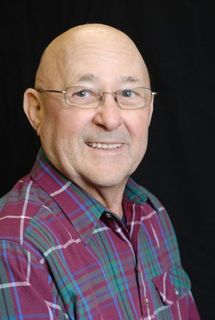 portrait of bald senior man with bright happy smile