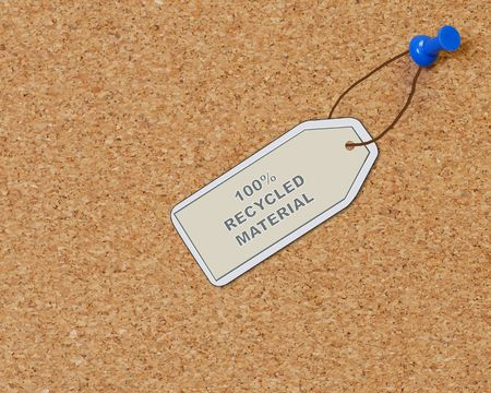 dispose: recycled material tag attached to corkboard with thumb tack