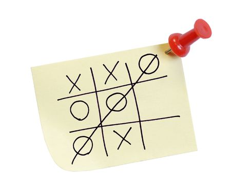 thumb tacked note with game of tic tac toe photo
