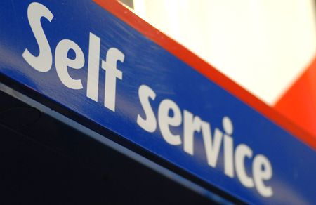 litre: self service sign seen at a gas bar  Stock Photo