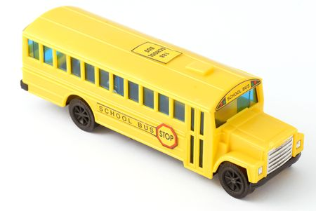 plastic yellow toy school bus on white background Stock Photo - 3224649