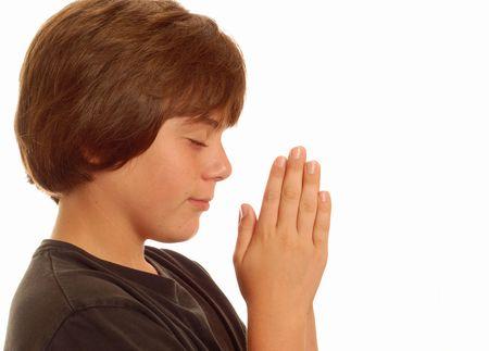 attractive thirteen year old boy praying photo