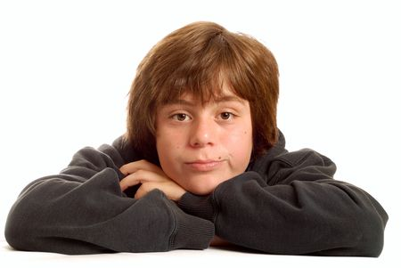 uninterested: attractive teen boy with arms crossed and bored expression isolated on white background Stock Photo
