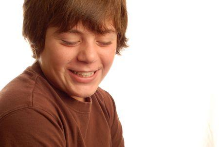 bashful: cute young teen boy with a bashful grin