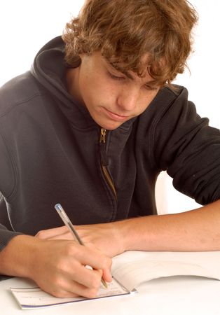 accrue: teenage boy writing check or doing financial accounting Stock Photo