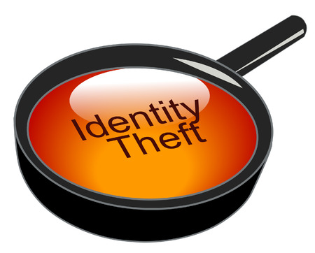 data theft: magnifying glass over top of identity theft  Illustration