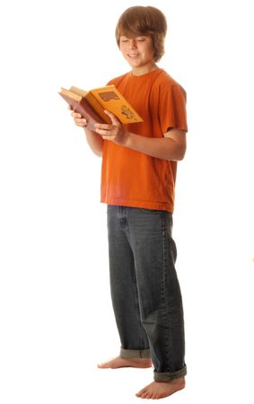 attractive young teenage boy reading a book isolated on white background Stock Photo