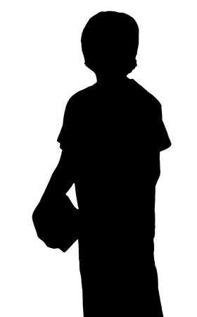 silhouette of a young adolescent boy carrying books photo