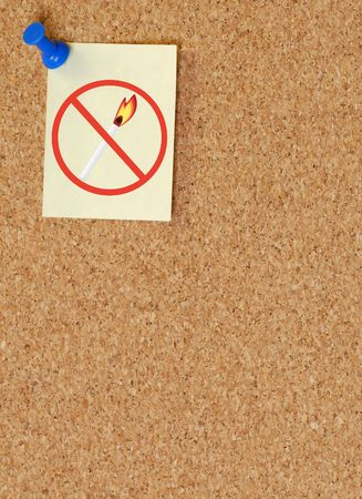 pyromania: no open flames sign on tacked to note on corkboard Stock Photo