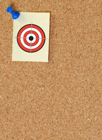 note with a target posted on a corkboard photo