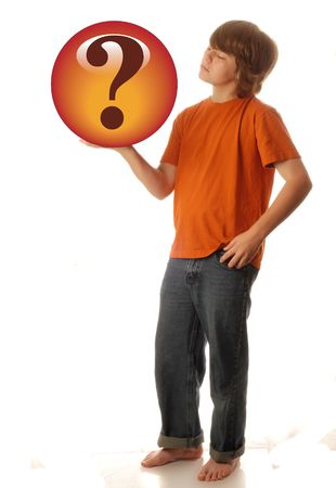 guess: young teen boy holding up question mark - looking for answers Stock Photo
