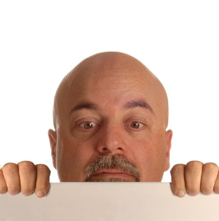 bald man holding up blank sign and straining to look over it Stock Photo - 3702891