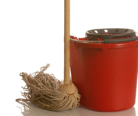 string mop and red bucket isolated on white background photo