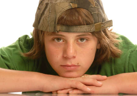 attractive young teen boy with ball cap on backwards