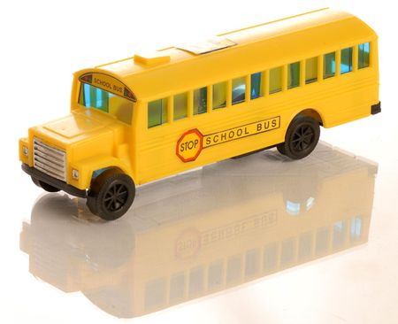 plastic yellow toy school bus on white background Stock Photo - 3756627