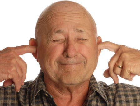 plugging: bald senior man plugging his ears isolated on white background