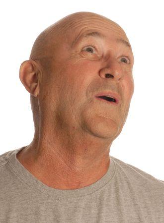 senior bald man making an oh expression photo