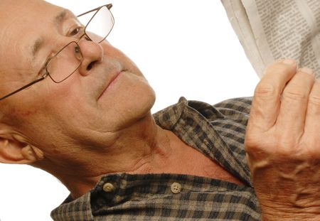 senior man with glasses reading the newspaper photo