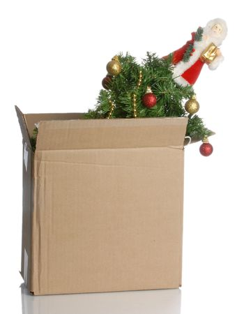 bah: christmas tree packed up in a box - no christmas this year