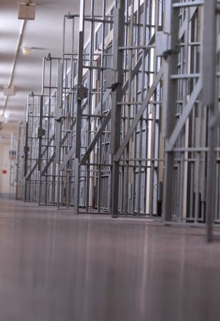row of open jail cells or a cell block  Stock Photo - 3962076